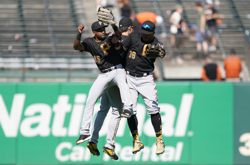SAN FRANCISCO, CALIFORNIA - SEPTEMBER 12: Pablo Reyes #15, Bryan Reynolds #10 and Jose Osuna #36 of the Pittsburgh Pirates celebrates defeating the San Francisco Giants 4-2 at Oracle Park on September 12, 2019 in San Francisco, California. (Photo by Thearon W. Henderson/Getty Images)