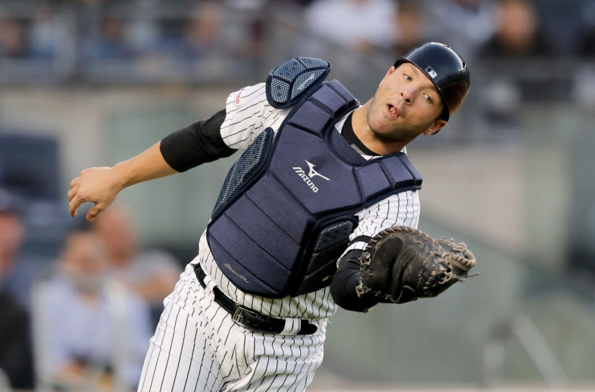NEW YORK, NEW YORK - SEPTEMBER 19: Austin Romine #28 of the New York Yankees makes the catch for the out in the first inning against the Los Angeles Angels at Yankee Stadium on September 19, 2019 in Bronx borough of New York City. (Photo by Elsa/Getty Images)