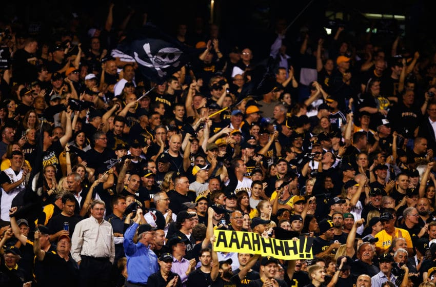 PITTSBURGH, PA - OCTOBER 01: Pittsburgh Pirates fans react in the seventh inning after a home run by Russell Martin #55 against the Cincinnati Reds during the National League Wild Card game at PNC Park on October 1, 2013 in Pittsburgh, Pennsylvania. (Photo by Justin K. Aller/Getty Images)