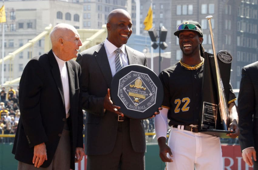 PITTSBURGH, PA - MARCH 31: Former Pirate MVPs Dick Groat and Barry Bonds stand with 2013 National League MVP Andrew McCutchen #22 of the Pittsburgh Pirates during Opening Day at PNC Park on March 31, 2014 in Pittsburgh, Pennsylvania. (Photo by Justin K. Aller/Getty Images)