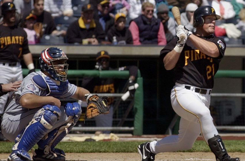 Pittsburgh Pirates' left fielder Brian Giles (R) hits a 2 RBI single off of Los Angeles Dodgers pitcher Hideo Nomo as Dodgers Catcher Chad Kreuter (L) watches during the third inning on 25 April, 2002 at PNC Park in Pittsburgh, PA. The Pirates defeated the Dodgers 3-2. AFP Photo/David Maxwell (Photo by David MAXWELL / AFP) (Photo credit should read DAVID MAXWELL/AFP via Getty Images)