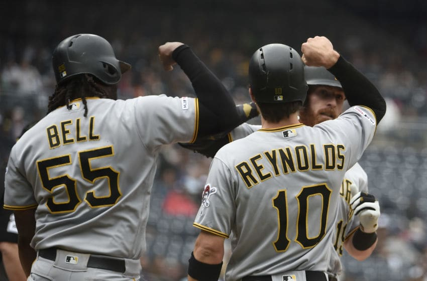 SAN DIEGO, CA - MAY 19: Colin Moran #19 of the Pittsburgh Pirates is congratulated by Josh Bell #55 and Bryan Reynolds #10 after hitting a three-run home run during the first inning of a baseball game against the San Diego Padres at Petco Park May 19, 2019 in San Diego, California. (Photo by Denis Poroy/Getty Images)