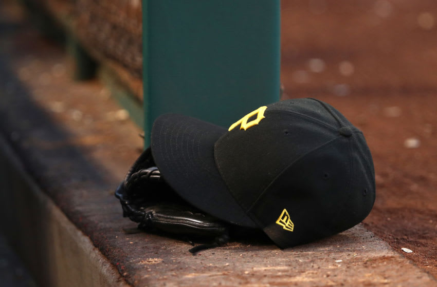 ANAHEIM, CALIFORNIA - AUGUST 14: A detalied view of a Pittsburgh Pirates hat and catching glove is seen on the dugout steps during the MLB game between the Pittsburgh Pirates and the Los Angeles Angels at Angel Stadium of Anaheim on August 14, 2019 in Anaheim, California. The Angels defeated the Pirates 7-4. (Photo by Victor Decolongon/Getty Images)