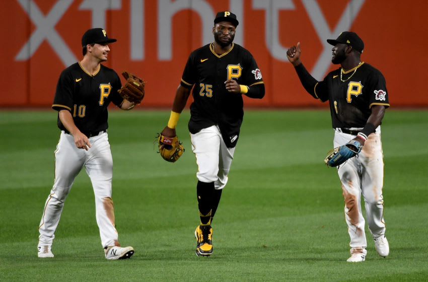 PITTSBURGH, PA - SEPTEMBER 04: Anthony Alford #6 of the Pittsburgh Pirates celebrates with Gregory Polanco #25 and Bryan Reynolds #10 after the final out of 4-3 win over the Cincinnati Reds during game two of a doubleheader at PNC Park on September 4, 2020 in Pittsburgh, Pennsylvania. (Photo by Justin Berl/Getty Images)