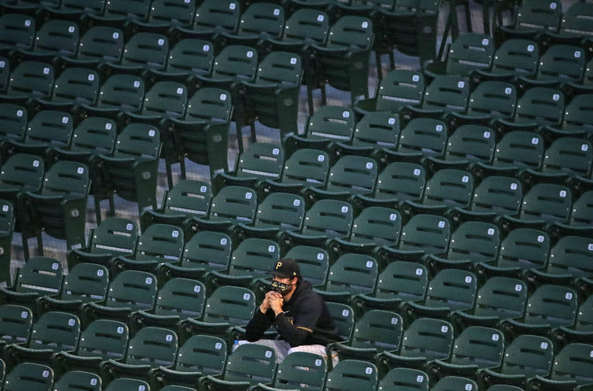 CHICAGO, ILLINOIS - AUGUST 01: A member of the Pittsburgh Pirates watches from the stands as his teammates take on the Chicago Cubs at Wrigley Field on August 01, 2020 in Chicago, Illinois. (Photo by Jonathan Daniel/Getty Images)