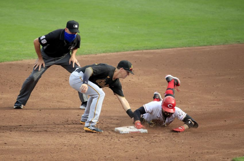 CINCINNATI, OHIO - AUGUST 13: Nick Castellanos #2 of the Cincinnati Reds slides in safely for a double ahead of the tag by Kevin Newman #27 of the Pittsburgh Pirates in the third inningat Great American Ball Park on August 13, 2020 in Cincinnati, Ohio. (Photo by Andy Lyons/Getty Images)