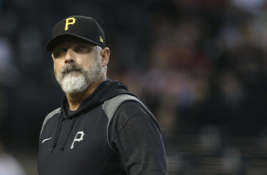 PHOENIX, ARIZONA - JULY 21: Manager Derek Shelton #17 of the Pittsburgh Pirates walks from the mound after a pitching change during the sixth inning of the MLB game against the Arizona Diamondbacks at Chase Field on July 21, 2021 in Phoenix, Arizona. (Photo by Ralph Freso/Getty Images)