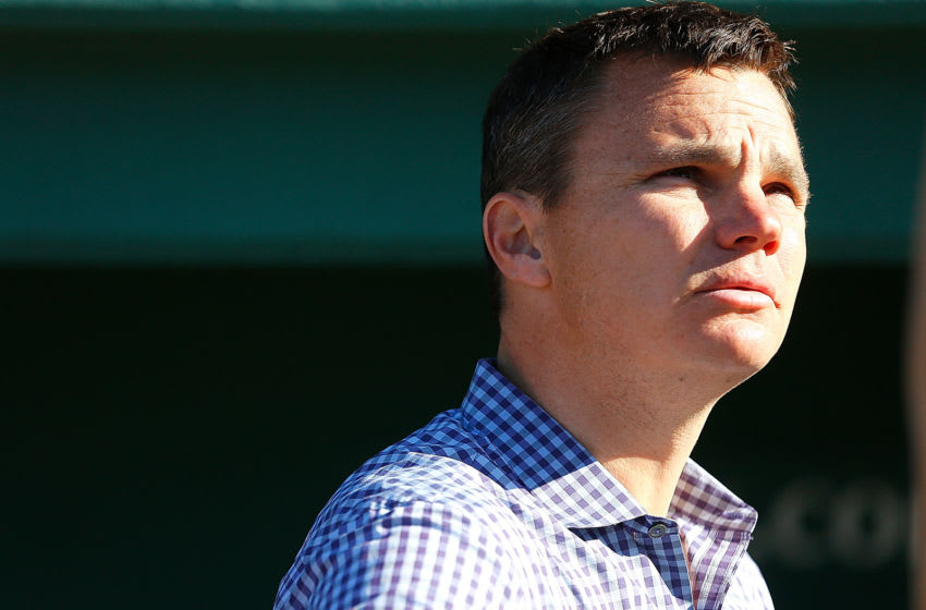 BOSTON, MA - MAY 6: Ben Cherington, general manager of the Boston Red Sox, watches batting practice from a the dugout before a game with the Minnesota Twins at Fenway Park on May 6, 2013 in Boston, Massachusetts. (Photo by Jim Rogash/Getty Images)