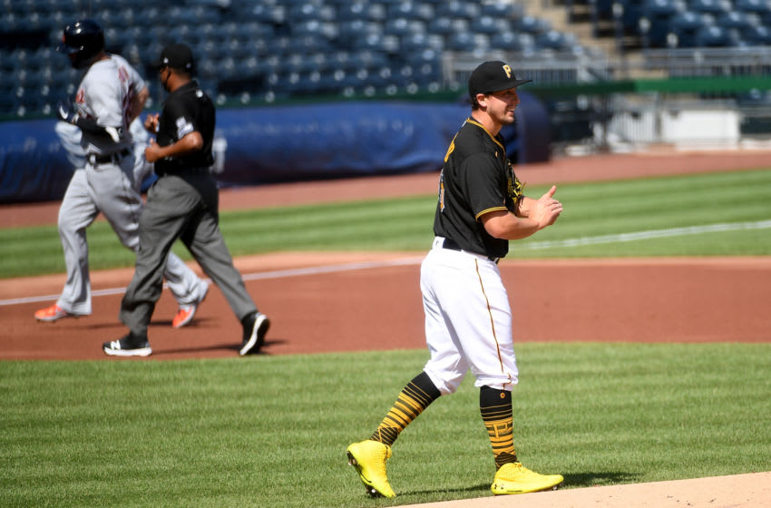 PITTSBURGH, PA - AUGUST 08: Derek Holland #45 of the Pittsburgh Pirates reacts as C.J. Cron #26 of the Detroit Tigers rounds the bases after hitting a solo home run in the first inning during the game at PNC Park on August 8, 2020 in Pittsburgh, Pennsylvania. (Photo by Justin Berl/Getty Images)