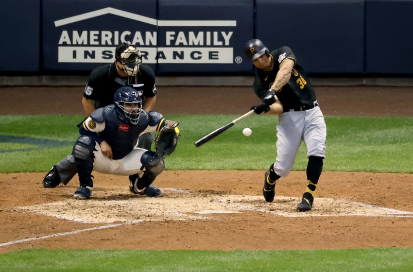 MILWAUKEE, WISCONSIN - AUGUST 31: Jose Osuna #38 of the Pittsburgh Pirates hits a single in the sixth inning against the Milwaukee Brewers at Miller Park on August 31, 2020 in Milwaukee, Wisconsin. (Photo by Dylan Buell/Getty Images)