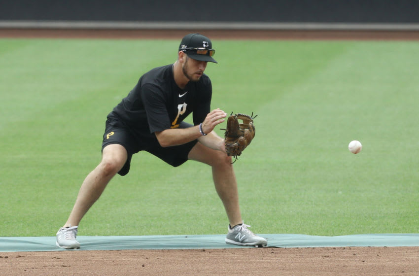Jul 7, 2020; Pittsburgh, Pennsylvania, United States; Pittsburgh Pirates second baseman JT Riddle (15) fields a ground ball during Summer Training workouts at PNC Park. Mandatory Credit: Charles LeClaire-USA TODAY Sports
