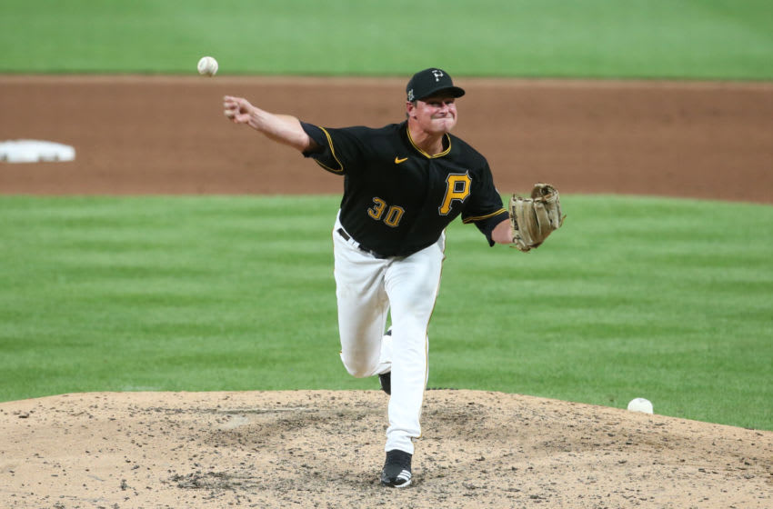 Jul 18, 2020; Pittsburgh, Pennsylvania, USA; Pittsburgh Pirates relief pitcher Kyle Crick (30) pitches against the Cleveland Indians during the eighth inning at PNC Park. Mandatory Credit: Charles LeClaire-USA TODAY Sports