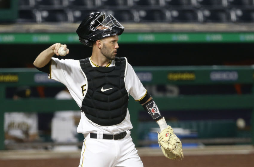 Jul 27, 2020; Pittsburgh, Pennsylvania, USA; Pittsburgh Pirates catcher Jacob Stallings (58) returns he ball to the pitcher against the Milwaukee Brewers during the third inning at PNC Park. Milwaukee won 6-5 in eleven innings. Mandatory Credit: Charles LeClaire-USA TODAY Sports