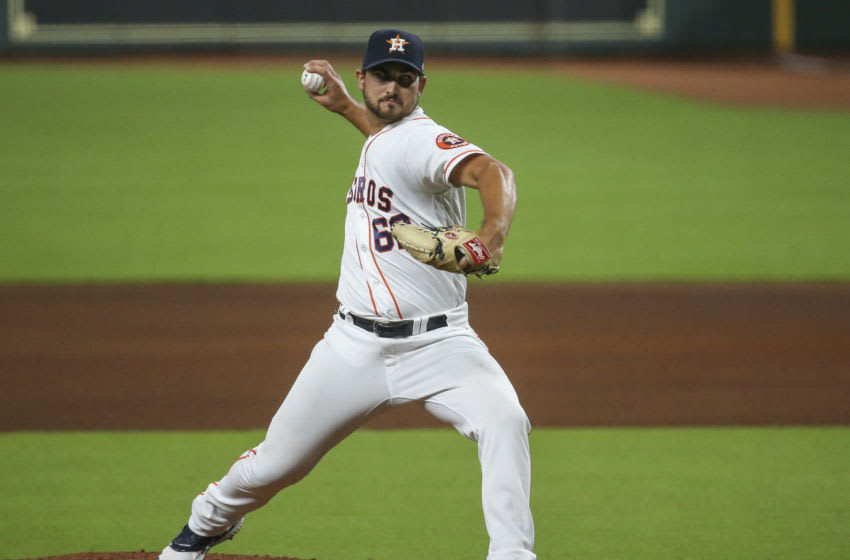 Aug 25, 2020; Houston, Texas, USA; Houston Astros relief pitcher Chase De Jong (69) delivers a pitch during the fifth inning against the Los Angeles Angels in game two of a double header at Minute Maid Park. Mandatory Credit: Troy Taormina-USA TODAY Sports