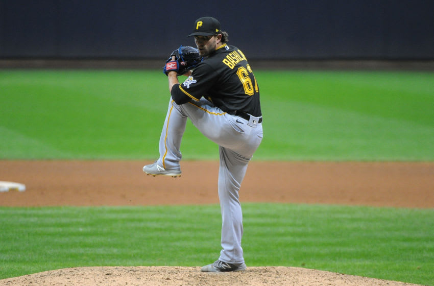 Aug 31, 2020; Milwaukee, Wisconsin, USA; Pittsburgh Pirates relief pitcher Tyler Bashlor (67) delivers a pitch against the Milwaukee Brewers in the seventh inning at Miller Park. Mandatory Credit: Michael McLoone-USA TODAY Sports