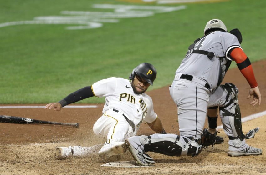 Sep 6, 2020; Pittsburgh, Pennsylvania, USA; Pittsburgh Pirates pinch runner Jason Martin (51) scores the game winning run behind Chicago White Sox catcher Yasmani Grandal (24) during the ninth inning at PNC Park. Grandal dropped the ball on the play for an error. The Pirates won 5-4. Mandatory Credit: Charles LeClaire-USA TODAY Sports