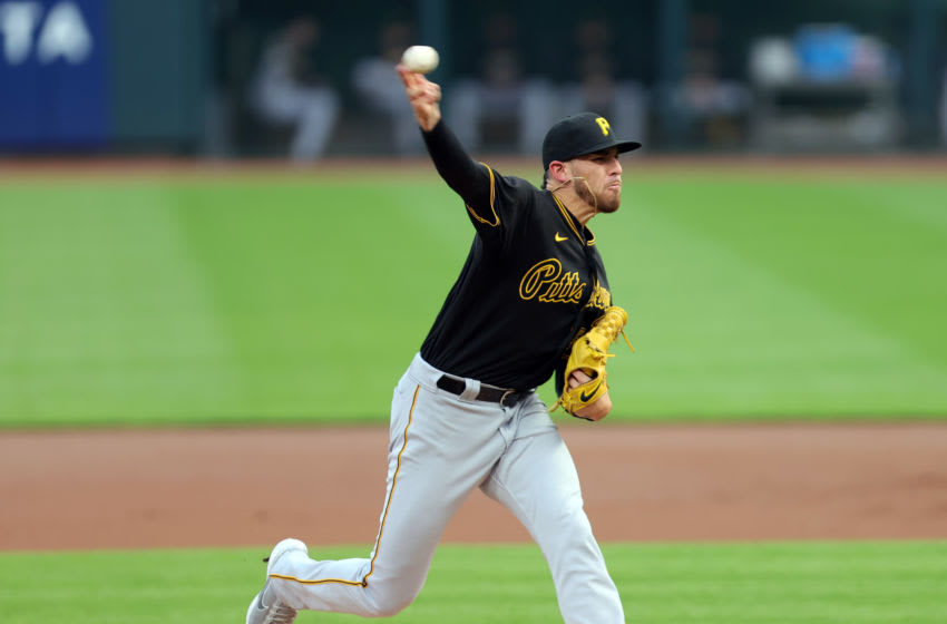 Sep 15, 2020; Cincinnati, Ohio, USA; Pittsburgh Pirates starting pitcher Joe Musgrove (59) pitches in the first inning in the game against Cincinnati at Great American Ball Park. Mandatory Credit: Jim Owens-USA TODAY Sports