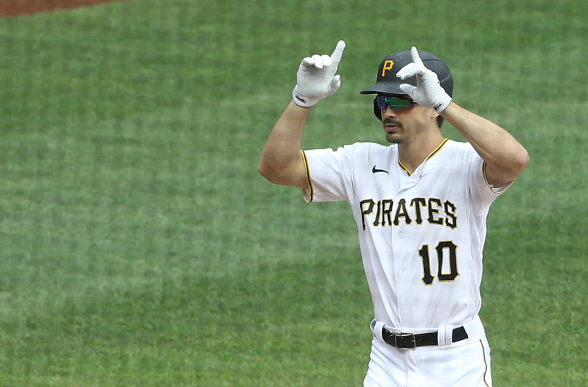Sep 24, 2020; Pittsburgh, Pennsylvania, USA; Pittsburgh Pirates center fielder Bryan Reynolds (10) gestures crossing home plate on a solo home run against the Chicago Cubs during the second inning at PNC Park. Mandatory Credit: Charles LeClaire-USA TODAY Sports