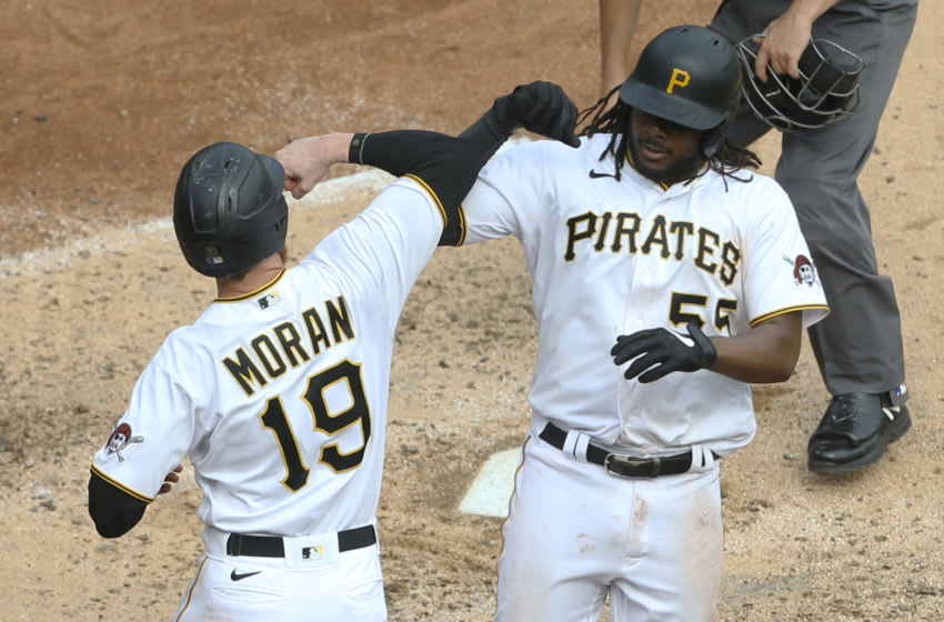 Sep 24, 2020; Pittsburgh, Pennsylvania, USA; Pittsburgh Pirates designated hitter Colin Moran (19) congratulates first baseman Josh Bell (55) on his two run home run against the Chicago Cubs during the fifth inning at PNC Park. Mandatory Credit: Charles LeClaire-USA TODAY Sports