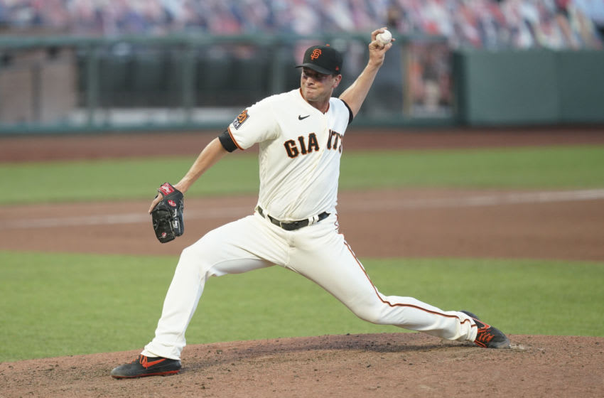 September 25, 2020; San Francisco, California, USA; San Francisco Giants relief pitcher Tony Watson (56) pitches during the seventh inning of game one of a double header against the San Diego Padres at Oracle Park. Mandatory Credit: Kyle Terada-USA TODAY Sports