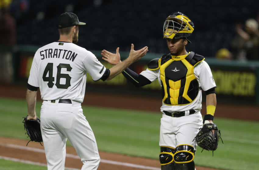 Apr 14, 2021; Pittsburgh, Pennsylvania, USA; Pittsburgh Pirates relief pitcher Chris Stratton (46) and catcher Michael Perez (R) celebrate on the field after defeating the San Diego Padres at PNC Park. Mandatory Credit: Charles LeClaire-USA TODAY Sports