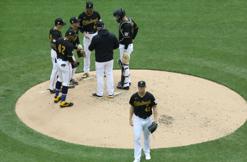 Apr 15, 2021; Pittsburgh, Pennsylvania, USA; Pittsburgh Pirates starting pitcher Mitch Keller (front) exits the mound after being removed from the game against the San Diego Padres during the fourth inning at PNC Park. Mandatory Credit: Charles LeClaire-USA TODAY Sports