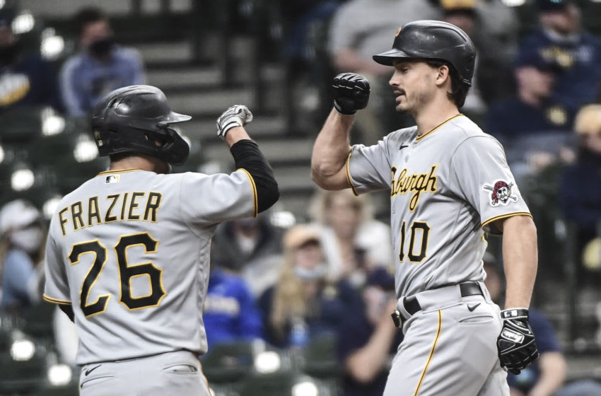 Apr 18, 2021; Milwaukee, Wisconsin, USA; Pittsburgh Pirates left fielder Bryan Reynolds (10) is greeted by second baseman Adam Frazier (26) after hitting a two-run home run in the seventh inning against the Milwaukee Brewers at American Family Field. Mandatory Credit: Benny Sieu-USA TODAY Sports