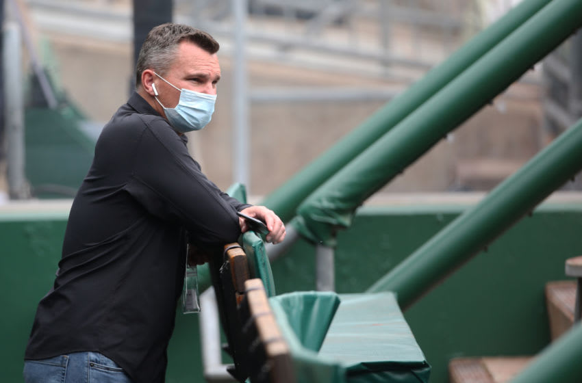 Apr 28, 2021; Pittsburgh, Pennsylvania, USA; Pittsburgh Pirates general manager Ben Cherington observes batting practice from the dugout before the game against the Kansas City Royals at PNC Park. Mandatory Credit: Charles LeClaire-USA TODAY Sports
