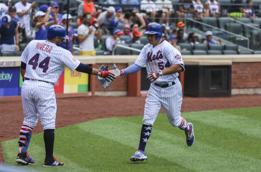 Jul 2, 2017; New York City, NY, USA; New York Mets third baseman TJ Rivera (54) is congratulated by catcher Rene Rivera (44) after hitting a home run in the fifth inning against the Phillies at Citi Field. Mandatory Credit: Wendell Cruz-USA TODAY Sports
