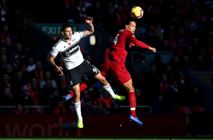 LIVERPOOL, ENGLAND - NOVEMBER 11: Aleksandar Mitrovic of Fulham battles for possession with Virgil van Dijk of Liverpool during the Premier League match between Liverpool FC and Fulham FC at Anfield on November 11, 2018 in Liverpool, United Kingdom. (Photo by Alex Livesey/Getty Images)