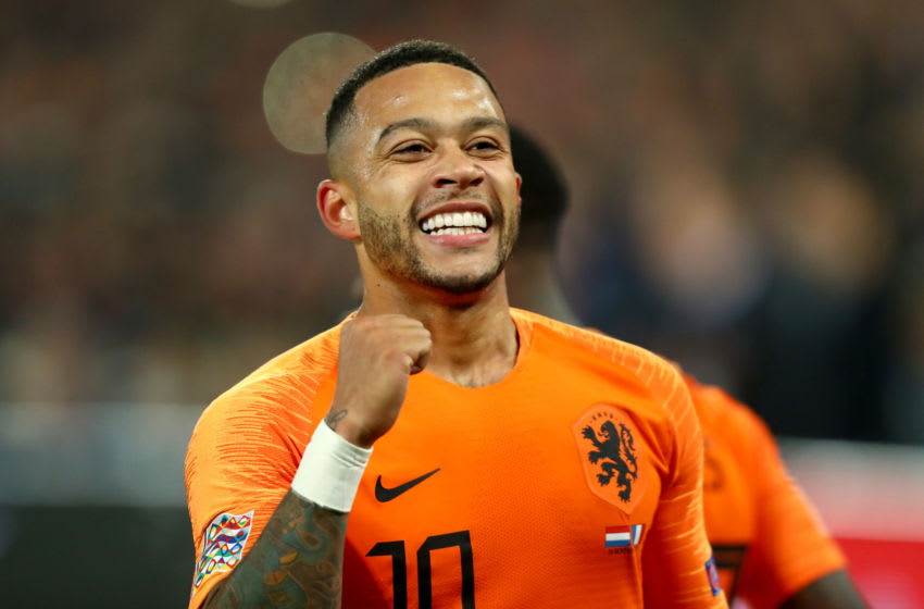 AMSTERDAM, NETHERLANDS - NOVEMBER 16: Memphis Depay of the Netherlands celebrates after scoring his team's second goal during the UEFA Nations League Group A match between Netherlands and France at the Stadion Feijenoord on November 16, 2018 in Amsterdam, Netherlands. (Photo by Dean Mouhtaropoulos/Getty Images)