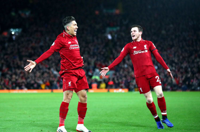 LIVERPOOL, ENGLAND - DECEMBER 29: Roberto Firmino of Liverpool celebrates with Andy Robertson after scoring his sides second goal during the Premier League match between Liverpool FC and Arsenal FC at Anfield on December 29, 2018 in Liverpool, United Kingdom. (Photo by Clive Brunskill/Getty Images)