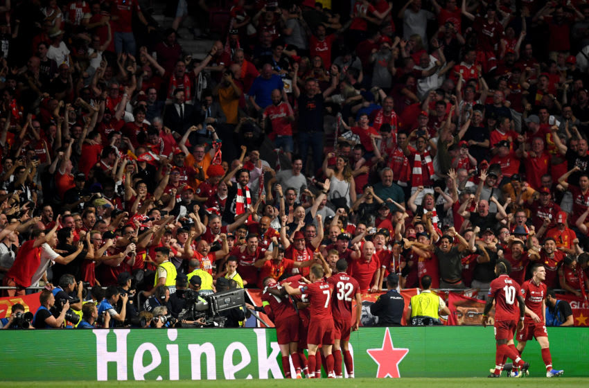 MADRID, SPAIN - JUNE 01: Liverpool players celebrate infront of Liverpolo fans after the second goal scored by Divock Origi during the UEFA Champions League Final between Tottenham Hotspur and Liverpool at Estadio Wanda Metropolitano on June 01, 2019 in Madrid, Spain. (Photo by Matthias Hangst/Getty Images)