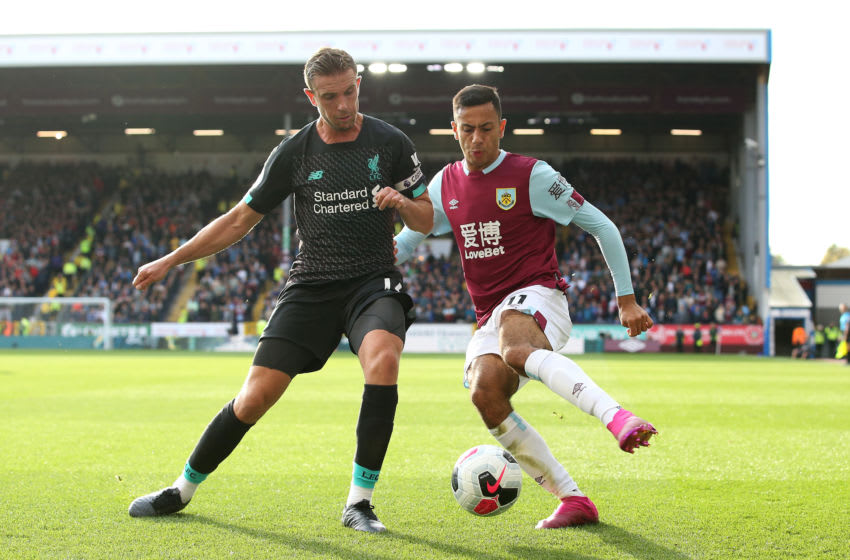 BURNLEY, ENGLAND - AUGUST 31: Jordan Henderson of Liverpool battles for possession with Dwight McNeil of Burnley during the Premier League match between Burnley FC and Liverpool FC at Turf Moor on August 31, 2019 in Burnley, United Kingdom. (Photo by Jan Kruger/Getty Images)