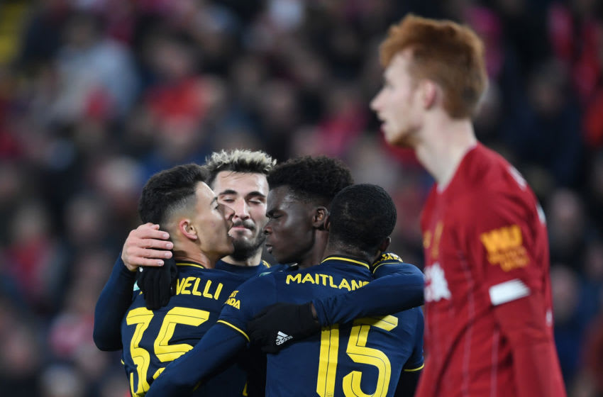 LIVERPOOL, ENGLAND - OCTOBER 30: Gabriel Martinelli of Arsenal celebrates after scoring his team's third goal with Sead Kolasinac, Bukayo Saka and Ainsley Maitland-Niles as Sepp Van Den Berg of Liverpool reacts during the Carabao Cup Round of 16 match between Liverpool and Arsenal at Anfield on October 30, 2019 in Liverpool, England. (Photo by Laurence Griffiths/Getty Images)