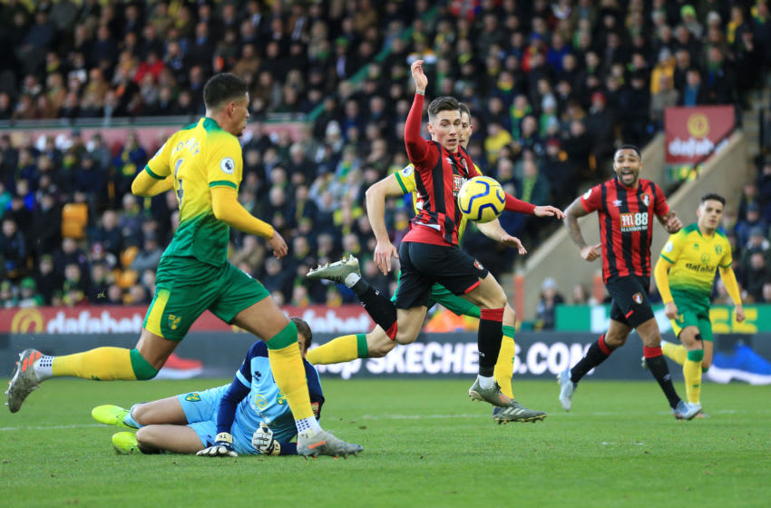 NORWICH, ENGLAND - JANUARY 18: Harry Wilson of AFC Bournemouth is challenged by Tim Krul of Norwich City during the Premier League match between Norwich City and AFC Bournemouth at Carrow Road on January 18, 2020 in Norwich, United Kingdom. (Photo by Stephen Pond/Getty Images)