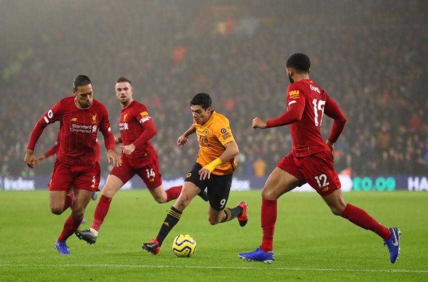 Liverpool, Virgil van Dijk, Roberto Firmino. (Photo by Catherine Ivill/Getty Images)