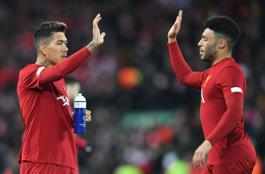 Liverpool, Roberto Firmino and Alex Oxlade-Chamberlain. (Photo by PAUL ELLIS/AFP via Getty Images)