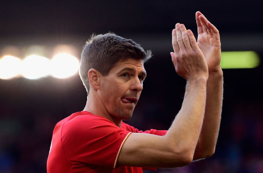 LIVERPOOL, ENGLAND - MAY 16: Steven Gerrard of Liverpool applauds the fans as he walks a lap of honour after his final game at Anfield during the Barclays Premier League match between Liverpool and Crystal Palace at Anfield on May 16, 2015 in Liverpool, England. (Photo by Stu Forster/Getty Images)