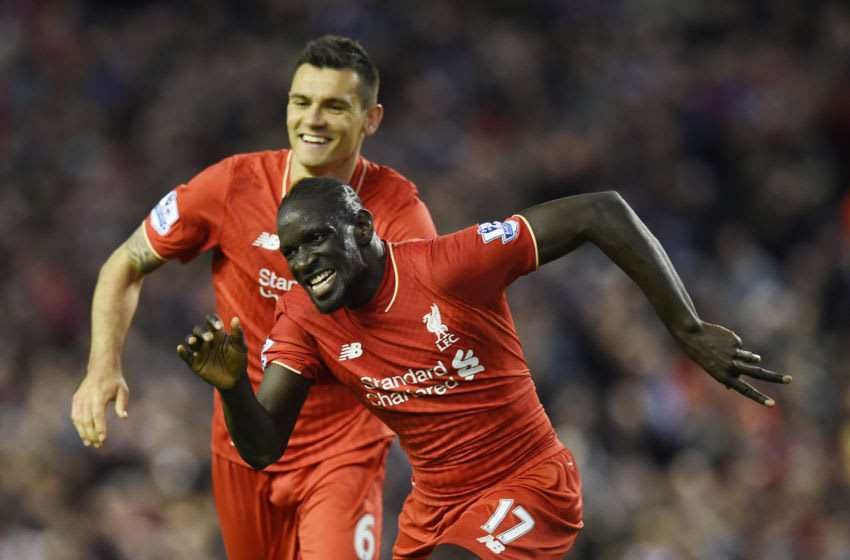 Liverpool's French defender Mamadou Sakho (R) celebrates with Liverpool's Croatian defender Dejan Lovren after scoring during the English Premier League football match between Liverpool and Everton at Anfield in Liverpool, north west England on April 20, 2016. / AFP / PAUL ELLIS / RESTRICTED TO EDITORIAL USE. No use with unauthorized audio, video, data, fixture lists, club/league logos or 'live' services. Online in-match use limited to 75 images, no video emulation. No use in betting, games or single club/league/player publications. / (Photo credit should read PAUL ELLIS/AFP via Getty Images)