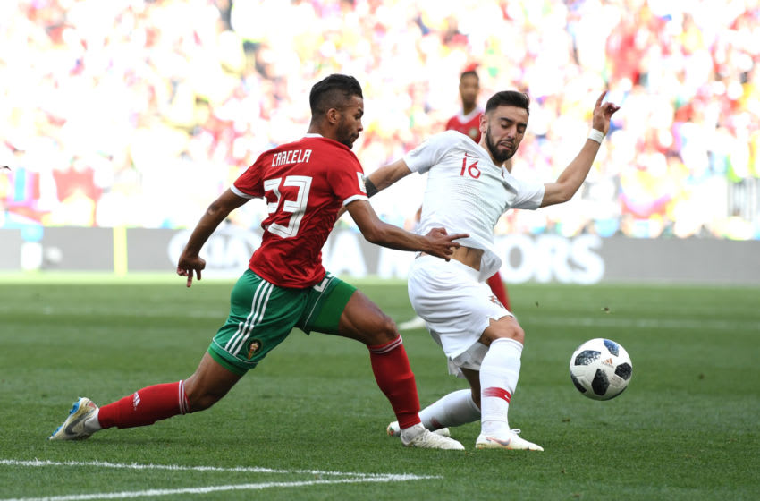 MOSCOW, RUSSIA - JUNE 20: Bruno Fernandes of Portugal is challenged by Mehdi Carcela of Morocco during the 2018 FIFA World Cup Russia group B match between Portugal and Morocco at Luzhniki Stadium on June 20, 2018 in Moscow, Russia. (Photo by Stu Forster/Getty Images)