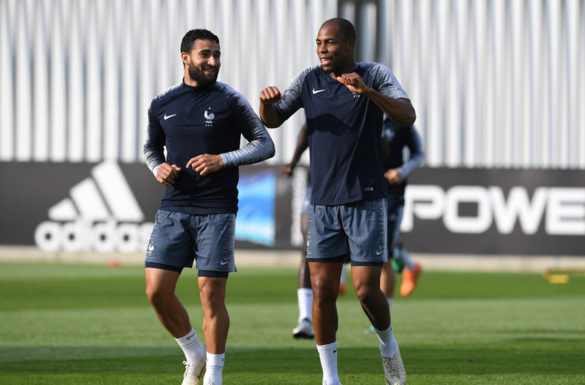 MOSCOW, RUSSIA - JULY 14: Djibril Sidibe of France speaks with Nabil Fekir of France during a France training session during the 2018 FIFA World Cup at Luzhniki Stadium on July 14, 2018 in Moscow, Russia. (Photo by Shaun Botterill/Getty Images)