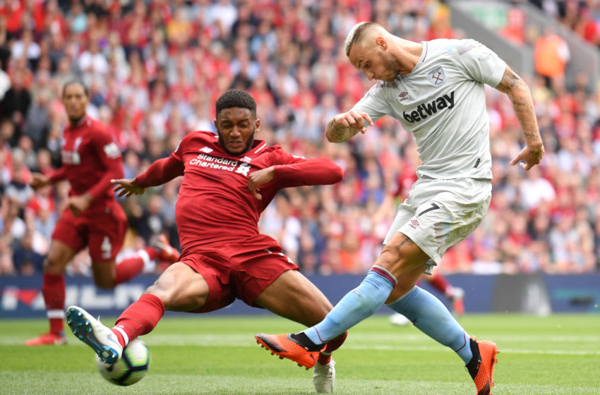 LIVERPOOL, ENGLAND - AUGUST 12: Marko Arnautovic of West Ham United takes a shot and is blocked by Joe Gomez of Liverpool during the Premier League match between Liverpool FC and West Ham United at Anfield on August 12, 2018 in Liverpool, United Kingdom. (Photo by Laurence Griffiths/Getty Images)