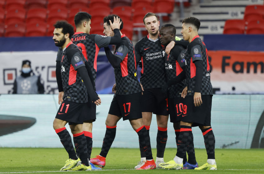 BUDAPEST, HUNGARY - FEBRUARY 16: Sadio Mane of Liverpool celebrates with team mates Jordan Henderson and Roberto Firmino after scoring their side's second goal during the UEFA Champions League Round of 16 match between RB Leipzig and Liverpool FC at Puskas Arena on February 16, 2021 in Budapest, Hungary. Liverpool face RB Leipzig at a neutral venue in Budapest behind closed doors after Germany imposed a ban on travellers arriving from the UK in an effort to prevent the spread of Covid-19 variants. (Photo by Laszlo Szirtesi/Getty Images)