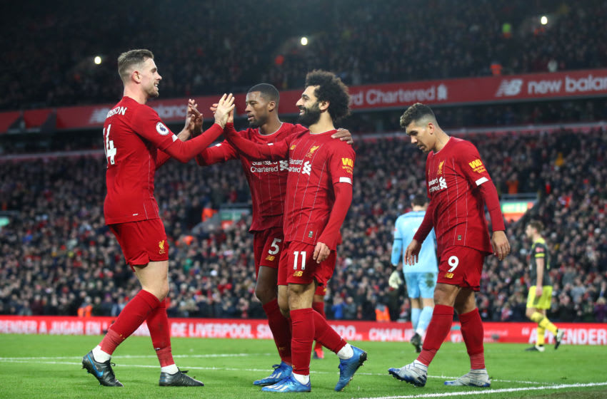 LIVERPOOL, ENGLAND - FEBRUARY 01: Mohamed Salah of Liverpool celebrates with Georginio Wijnaldum, Jordan Henderson and Roberto Firmino after scoring his team's third goal during the Premier League match between Liverpool FC and Southampton FC at Anfield on February 01, 2020 in Liverpool, United Kingdom. (Photo by Julian Finney/Getty Images)