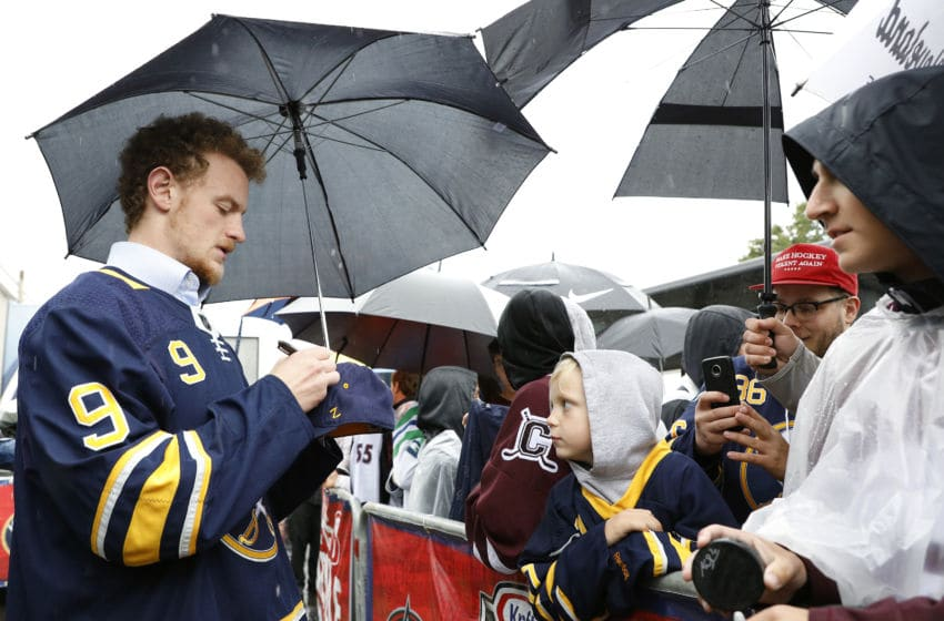 CLINTON, NY - SEPTEMBER 25: Jack Eichel #9 of the Buffalo Sabres signs autographs for fans on the red carpet during the NHL Kraft Hockeyville USA at Clinton Arena on September 25, 2018 in Clinton, New York. (Photo by Patrick McDermott/NHLI via Getty Images)