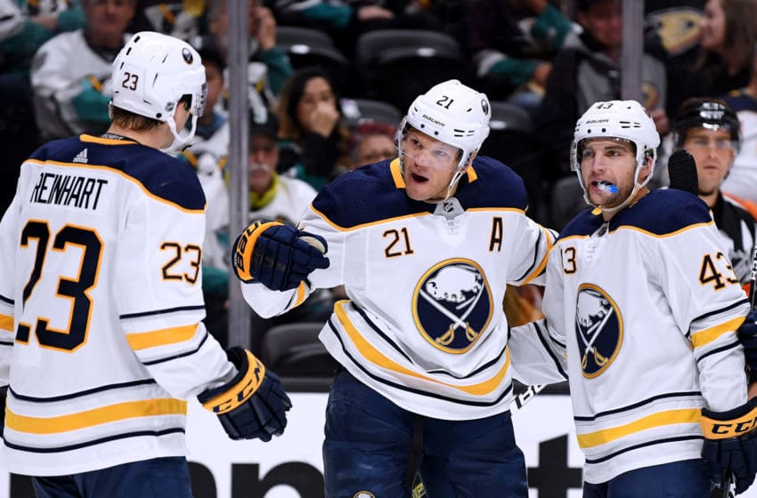 ANAHEIM, CA - OCTOBER 21: Kyle Okposo #21 of the Buffalo Sabres celebrates his goal with Sam Reinhart #23 and Conor Sheary #43 to trail 2-1 to the Anaheim Ducks during the second period at Honda Center on October 21, 2018 in Anaheim, California. (Photo by Harry How/Getty Images)