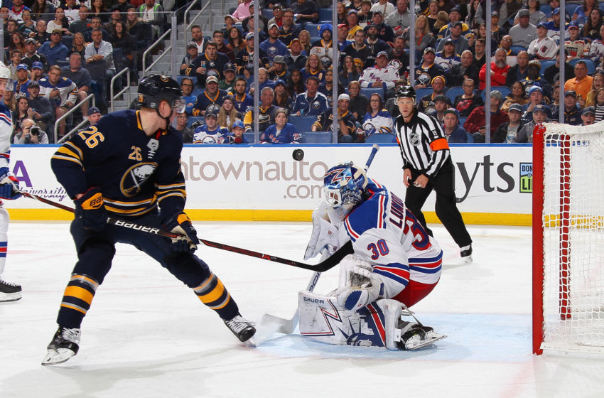 BUFFALO, NY - OCTOBER 6: Rasmus Dahlin #26 of the Buffalo Sabres shoots against Henrik Lundqvist #30 of the New York Rangers during an NHL game on October 6, 2018 at KeyBank Center in Buffalo, New York. (Photo by Bill Wippert/NHLI via Getty Images)