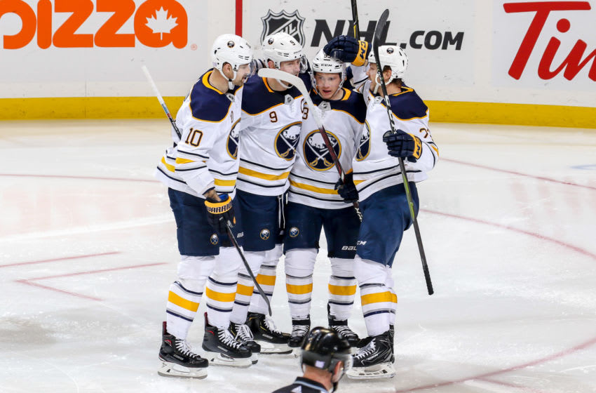 WINNIPEG, MB - NOVEMBER 16: Patrik Berglund #10, Jack Eichel #9, Jeff Skinner #53 and Sam Reinhart #23 of the Buffalo Sabres celebrate a third period goal against the Winnipeg Jets at the Bell MTS Place on November 16, 2018 in Winnipeg, Manitoba, Canada. (Photo by Jonathan Kozub/NHLI via Getty Images)