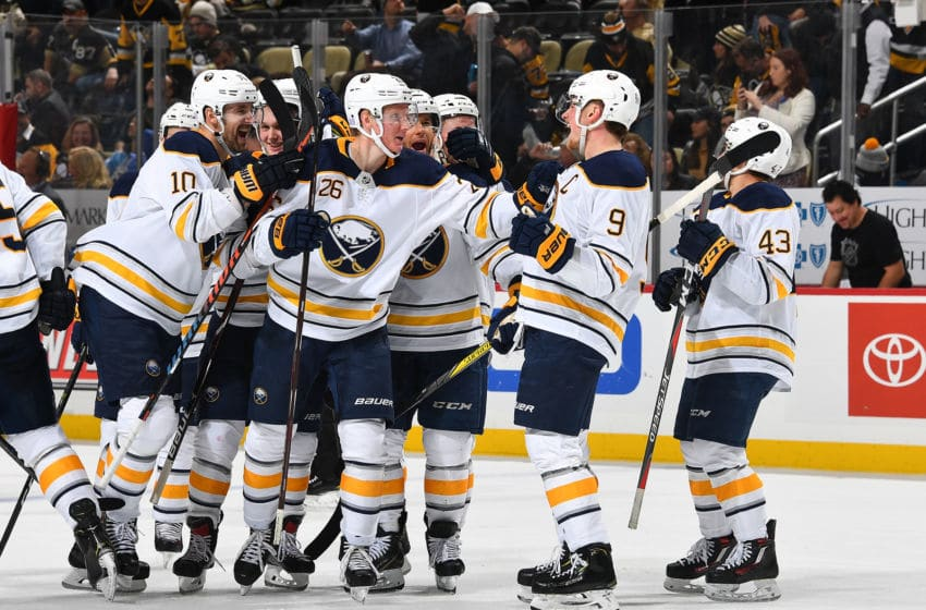 PITTSBURGH, PA - NOVEMBER 19: Jack Eichel #9 of the Buffalo Sabres celebrates his overtime goal with teammates against the Pittsburgh Penguins at PPG Paints Arena on November 19, 2018 in Pittsburgh, Pennsylvania. (Photo by Joe Sargent/NHLI via Getty Images)